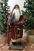 Small Santa Holding Bottle Brush Tree and Lantern