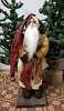 Small Slim Santa with Mustard Coat Holding Red Stocking