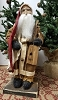 Small Santa with Brown Coat Holding Banjo