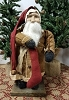 Small Fat Santa with Brown Coat Holding Candle with Stocking