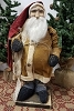 Small Fat Santa with Mustard Coat with Black Sack on Back