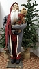 Tall Santa with Blue Coat Holding Bear