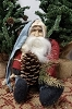 Sitting Santa with Red Coat Holding Pinecone