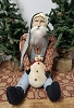 Sitting Santa with Blue Overalls Holding Snowman