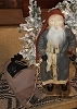 Santa with Blue Coat Holding Candle and Pulling Sled