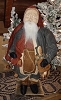 Santa with Blue Coat Holding Doll
