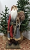 Santa with Blue Coat Holding Stick Horse with Stocking