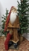 Santa with Brown Coat Holding Red Stocking and Candle