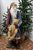 Tall Santa with Blue Plaid Coat Holding Bear