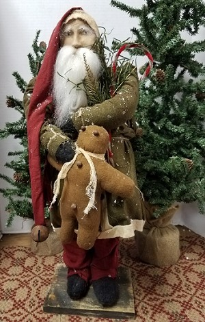 Tall Fat Santa with Green Coat Holding Gingerbread