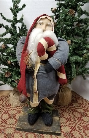 Santa with Blue Coat Holding Candy Cane