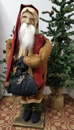 Tall Santa with Brown Coat Holding Stocking with Black Sack