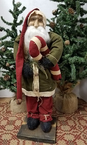 Santa with Green Coat Holding Candy Cane