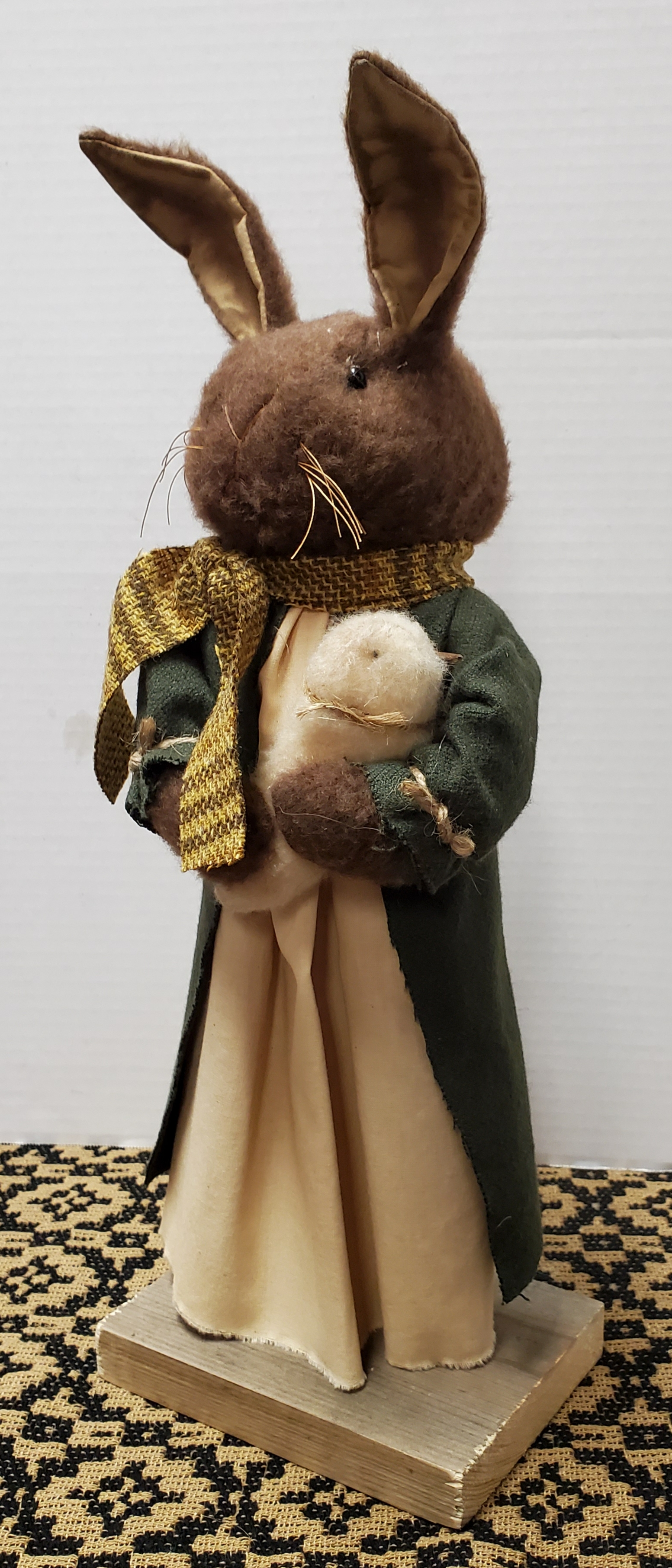 Brown Bunny with Muslin Dress and Green Coat Holding Chick