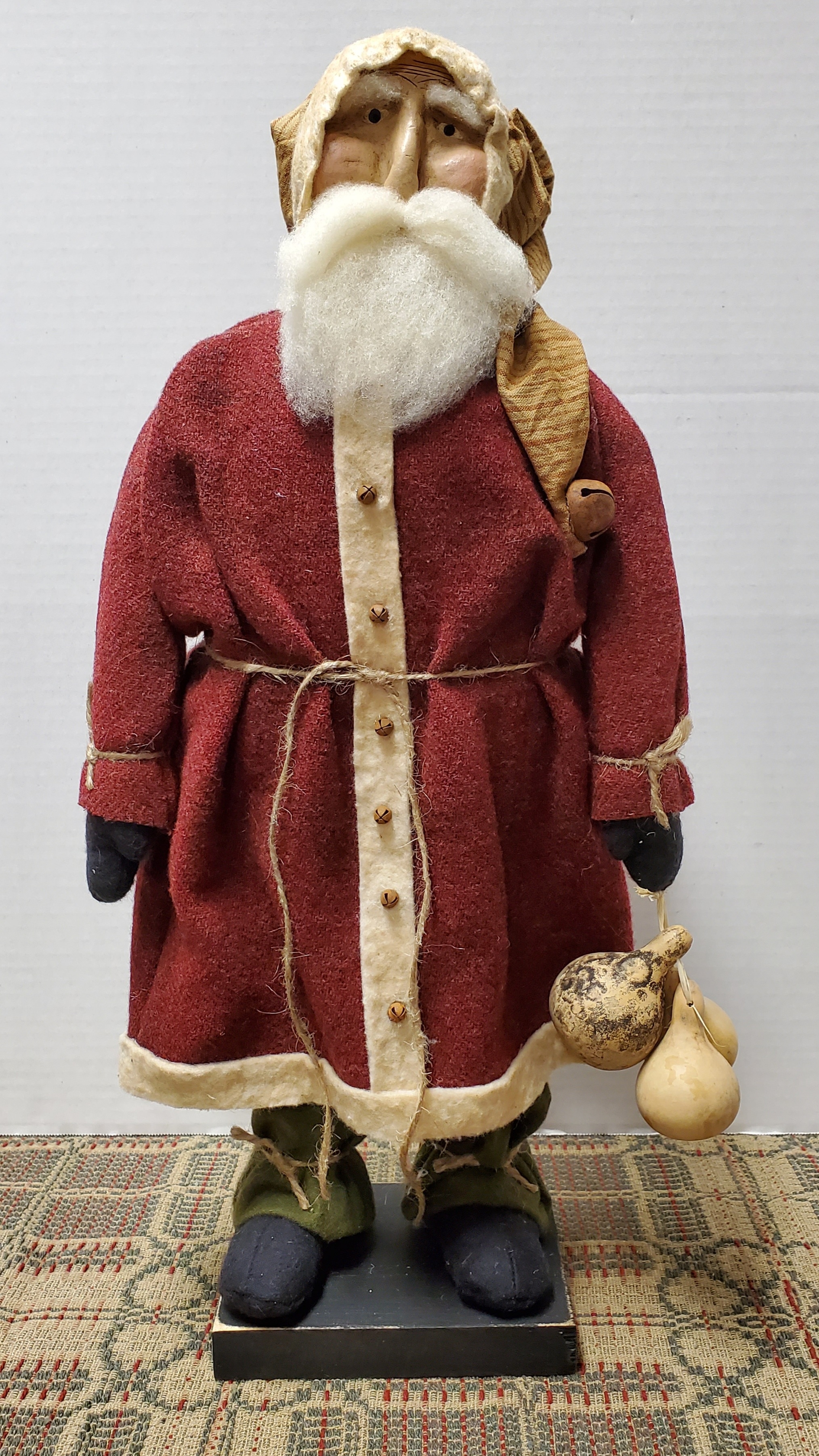 Medium Santa with Red Wool Coat Holding Gourds