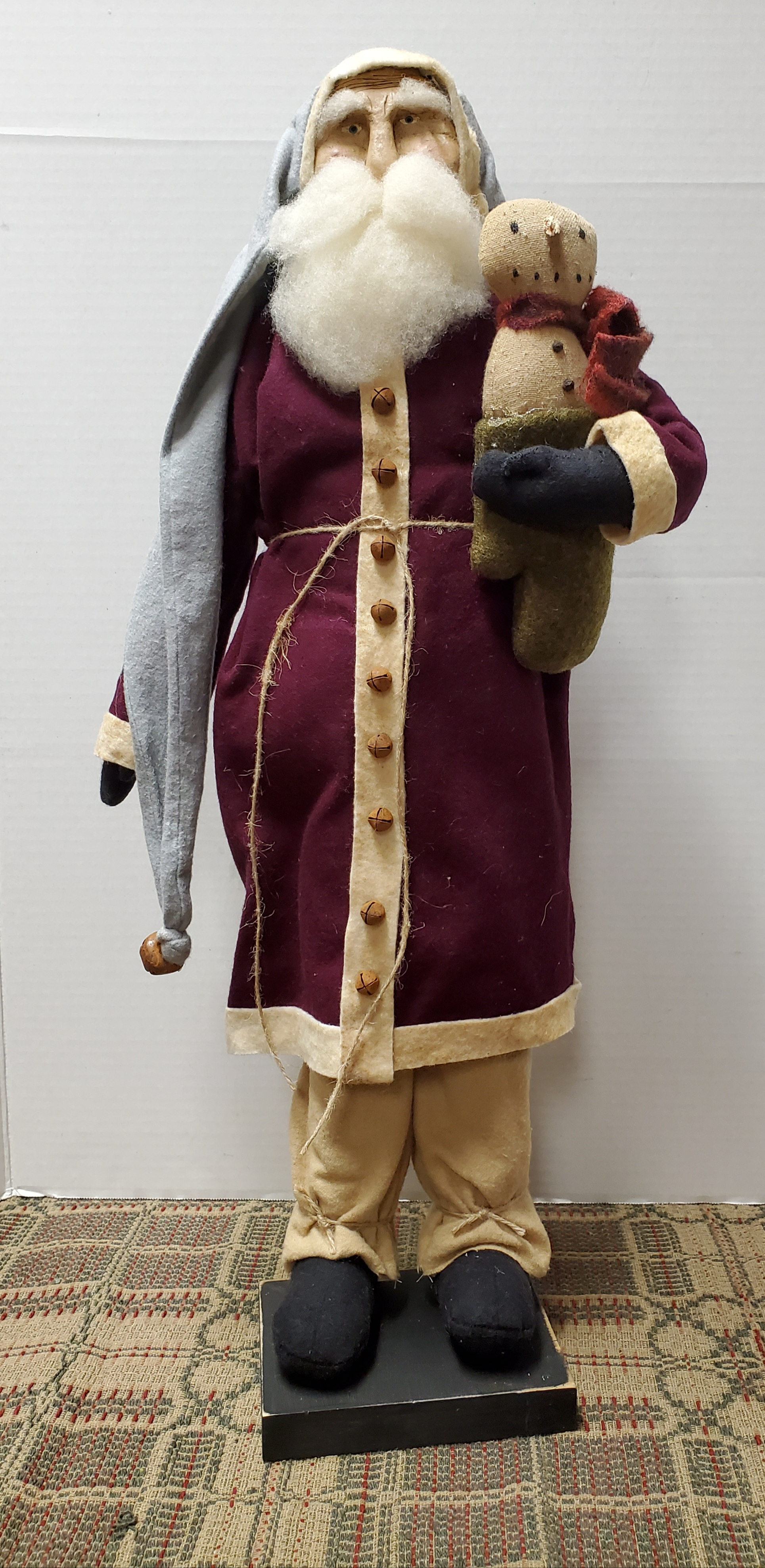 Large Santa with Burgundy Coat Holding Snowman in Green Mitten