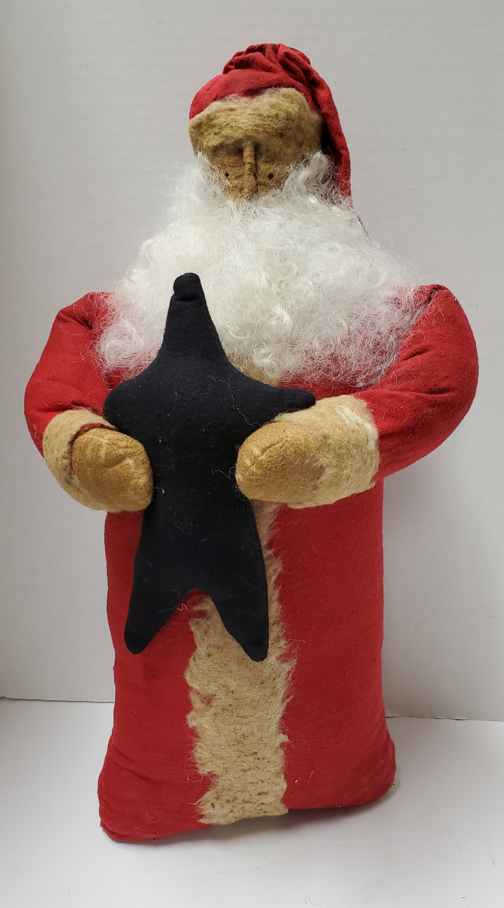 SANTA WITH RED COAT AND CAP HOLDING BLACK STAR