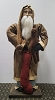 Arnett Santa with Brown Homespun Coat Holding a Gingerbread Man and Stocking