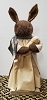 Brown Bunny with Muslin Dress Holding Chick