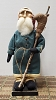 Small Santa with Blue Wool Coat Holding Reindeer on Stick