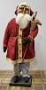 Medium Santa with Red Coat Holding Reindeer on Stick