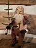 Arnett  Santa Holding Christmas Goose and Feather Tree