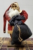 Primitive Arnett Santa In Red Coat Holding Black Bag