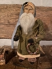 Primitive Arnett Santa In Green Coat and Tan Pants Holding Wreath