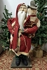 Tall Fat Santa with Red Coat Holding Snowman with Top Hat
