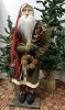 Tall Slim Santa with Green Coat with Sweet Gum Ball Wreath
