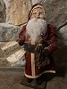 Primitive Arnett Santa In Red Holding Doll