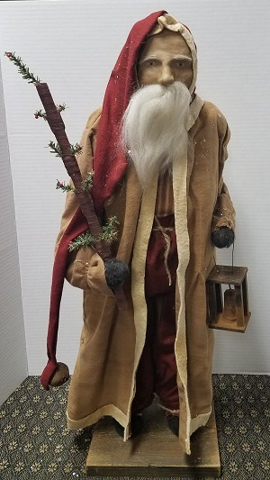 Arnett Santa with Tobacco Coat Holding a Feather Tree and Lantern